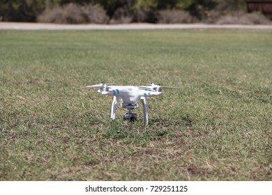 PHOENIX - MAY 15: DJI Phantom quadcopter drone with built in high definition still frame and video recording camera sitting in grass prepared to takeoff on May 15, 2016 in Phoenix, AZ.