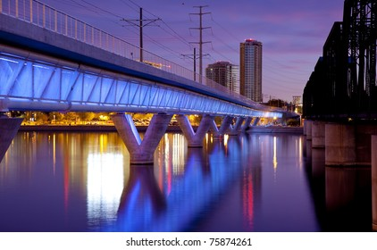 Phoenix Metro light rail bridge across the Salt River in Tempe Arizona photographed at sunset.