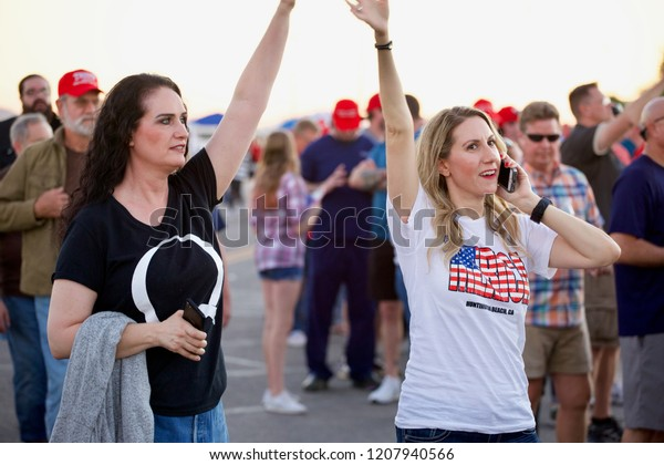 PHOENIX – OCTOBER 19 2018: Trump supporters and protesters gather outside a campaign rally (and accompanying anti-Trump protest) for President Trump and US Senate candidate Martha McSally.