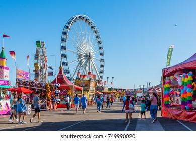 Phoenix, United States - October 25, 2017: People stroll among the games, rides, and concession stands at the Arizona State Fair.
