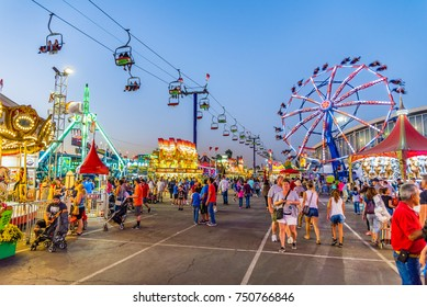 Phoenix, United States - October 25, 2017: People stroll through the midway at the Arizona State Fair.
