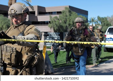 Phoenix / US - January 30, 2013: Phoenix Police Department officers search and secure an office building after a workplace shooting leaves two people dead, one injured and a suspect at large. 1052