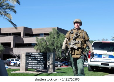 Phoenix / US - January 30, 2013: Phoenix Police Department officers search and secure an office building after a workplace shooting leaves two people dead, one injured and a suspect at large. 1063