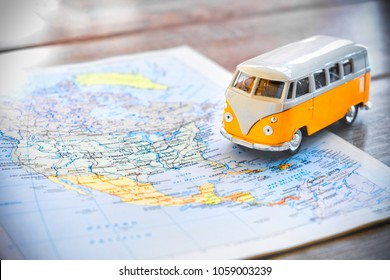 Phoenix, USA, 1 Apr 2018 - An hippie van model on a North America map USA on the road trip globetrotter traveler
