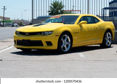 Phoenix, USA - June 08 2018: Yellow Chevrolet Camaro on a parking lot. The Camaro is an American automobile manufactured by Chevrolet, classified as a pony car and some versions also as a muscle car.