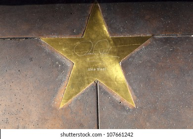 PHOENIX, USA - JUNE 14: star of Mae West in copper reflect the past glory of the Hotel San Carlos on June 14,2012 in Phoenix, USA. The stars in the sidewalk were put in due to their visits.