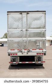 Phoenix, USA - March 15, 2016: trailer rear side of a huge white Peterbilt truck parked on a parking in Phoenix, Arizona. Peterbilt manufactures medium and heavy-duty trucks since 1939.