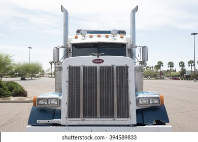 Phoenix, USA - March 15, 2016: front view of a huge white Peterbilt truck parked by the road in Phoenix, Arizona. Peterbilt manufactures medium and heavy-duty trucks since 1939.