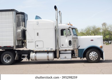 Phoenix, USA - March 15, 2016: side view of a huge white Peterbilt truck parked on a parking in Phoenix, Arizona. Peterbilt manufactures medium and heavy-duty trucks since 1939.