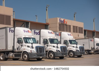 Phoenix,Az/USA - 8.16.19: Large FedEx delivery trucks at warehouse facility at SkyHarbor Airport in Phoenix.  FedEx is an American multinational courier delivery service headquater in Memphis, Tn.