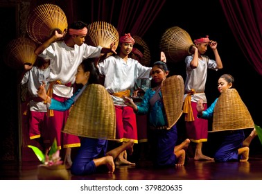 PHOM PENH, CAMBODIA - JANUARY 10, 2013: Khmer folk dancers performing Phloy Suoy (Harvest Dance) in traditional costume in Phnom Penh, Cambodia.