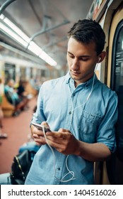 Phone addict man using gadget in metro