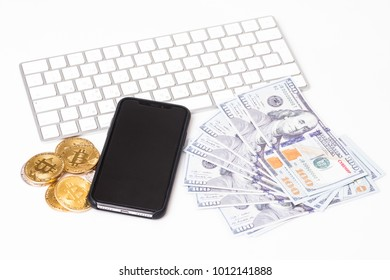 Phone with bitcions and dollar cash near keyboard isolated on white