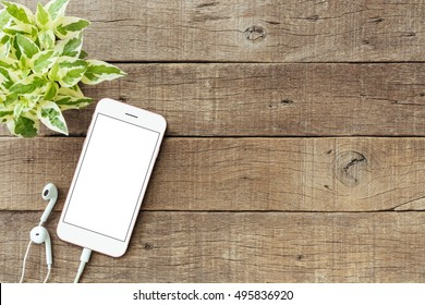 phone blank white screen on old wood table, mockup phone rose gold color