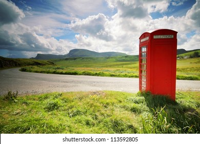 Phone booth in the middle of a green field