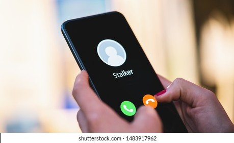 Phone call from a anonymous stalker. Stalking or bullying with phone concept. Stalker caller, scammer or stranger. Woman answering a incoming call. Ex boyfriend with fake identity.