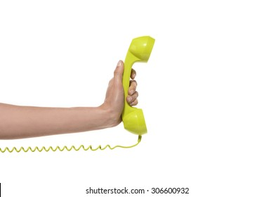 Phone call. Hand holding a green phone.