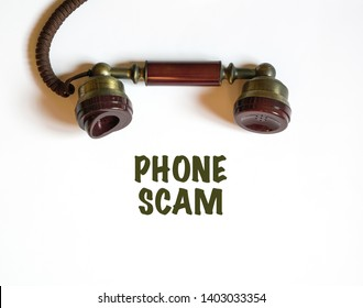 Phone call that is a scam. An antique telephone receiver with the text phone scam printed below it.