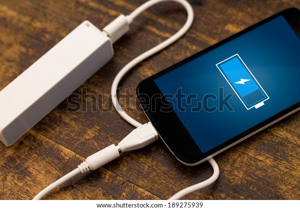 Phone charging with energy bank. Depth of field on Power bank