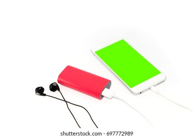 Phone charging with energy bank Power bank  and headphones on white background.