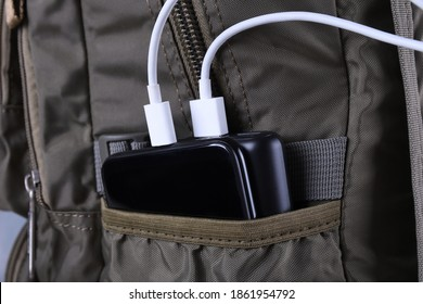 Phone charging,powerbank charges smartphone,cellphone with energy bank. Depth a of field on Power bank in the backpack bag