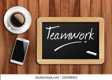 Phone, Coffee And A Chalkboard On The Wooden Table Written Teamwork.