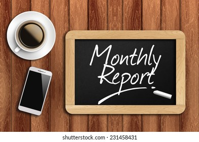 Phone, Coffee And A Chalkboard On The Wooden Table Written Monthly Report.