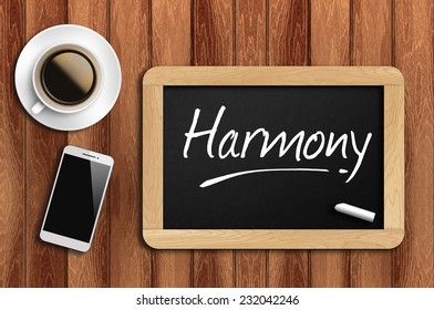 Phone, Coffee And A Chalkboard On The Wooden Table Written Harmony.