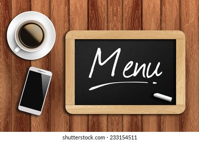 Phone, Coffee And A Chalkboard On The Wooden Table Written Menu.