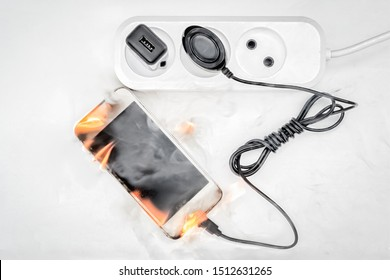 Phone is connected to power supply in case of fire, concept of fake power supply unit