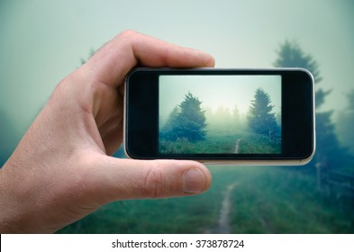 phone in hand man (photographing the landscape) photos from your phone, Self, photographing on the phone, the man photographs the mountain landscape on the phone (smartphone)