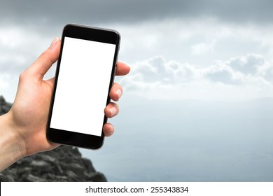 phone in the hands of women and mountains in the background