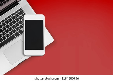 Phone and laptop on desk