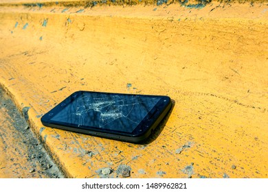 the phone lies on a rough concrete surface architectural and urban object.