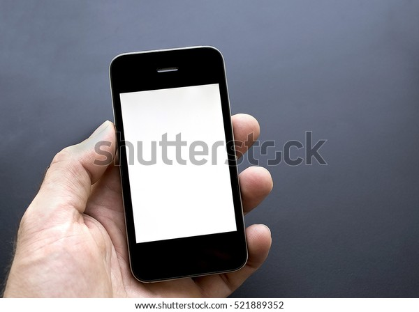 phone in the male hand with white   isolated screen on a black background
