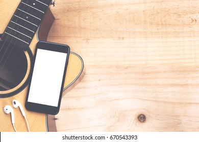 phone mobile showing screen on guitar top view music concept