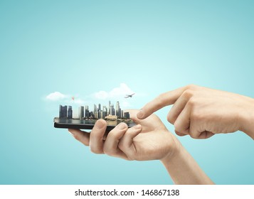 phone with model city in hands