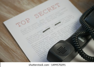 Phone off the hook with top secret document containing classified information
