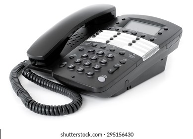 Phone on white background. Picture of a modern black business office telephone isolated on a white background.