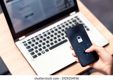Phone password lock for mobile cyber security or login verification passcode in online bank app. Data privacy and protection from hacker, identity thief or cybersecurity threat. Laptop and smartphone.