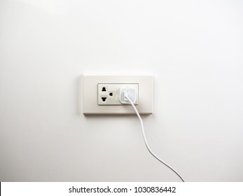 Phone plugged in on socket wall, charging