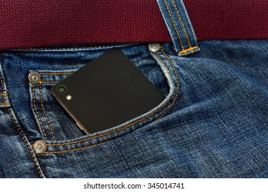 the phone is in the pocket of jeans. Focus on the phone.