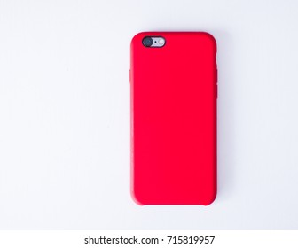 The phone is in a red cover