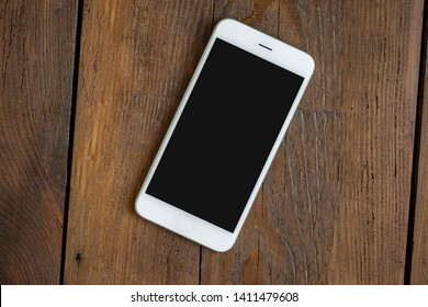 Phone screen empty on a wooden teble top view