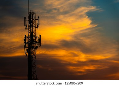 Phone tower with belly in the evening.