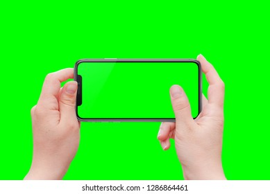 Phone in woman hands. Horizontal position. Isolated in green, chroma key for video editors.
