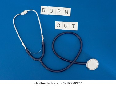 Phonendoscope with writing burn out represents the concept of burn out for health personnel