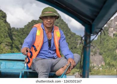 Phong Nha, Quang Bihn,Vietnam - 11/28/2-18:  Boatsman earning a living from taking tourists to the Phong Nha Caves.