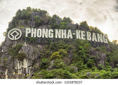 Phong Nha, Vietnam - April 9, 2018: White sign of Phong Nha-Ke Bang National Park on mountain at Phong Nha Village in Vietnam. Phong Nha-Ke Bang National Park is home to the largest cave in the world.