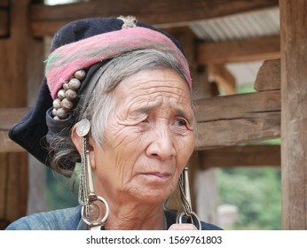 Phongsaly, Laos - november 2, 2019: portrait old woman wearing traditional turban belonging to minority ethnic group living in hilltribe villages around Muang Sing, North Laos.